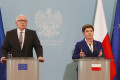 Poland's Prime Minister Beata Szydlo, right, and EU Commission Vice President Frans Timmermans, left, tell reporters efforts continue, with EU support to end soon Poland's political conflict that has strained ties with Brussels, at Szydlo's office in Warsaw, Poland, on Tuesday, 24 May 2016. Alarmed by government moves that have paralyszed the Constitutional Tribunal, the EU Commissions has threatened sanctions if the political conflict is not solved, but the meeting suggested that sanctions were less likely.  (AP Photo/Czarek Sokolowski)