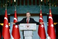 Turkey's President Tayyip Erdogan addresses the audience during a meeting in Ankara, Turkey, January 12, 2016. Erdogan said on Tuesday that Russia was preparing the ground to create a 'boutique' Syrian state around the northern province of Latakia and that it has been carrying out attacks against Turkmens there. In a speech to Turkish ambassadors in Ankara, Erdogan also slammed Iran, saying Tehran was using developments in countries like Syria, Iraq and Yemen to expand its sphere of influence and that it was trying to spark a dangerous process with a stance turning sectarian differences into conflict. REUTERS/Kayhan Ozer/Presidential Palace Press Office/Handout via Reuters ATTENTION EDITORS - THIS PICTURE WAS PROVIDED BY A THIRD PARTY. REUTERS IS UNABLE TO INDEPENDENTLY VERIFY THE AUTHENTICITY, CONTENT, LOCATION OR DATE OF THIS IMAGE. THIS PICTURE IS DISTRIBUTED EXACTLY AS RECEIVED BY REUTERS, AS A SERVICE TO CLIENTS. FOR EDITORIAL USE ONLY. NOT FOR SALE FOR MARKETING OR ADVERTISING CAMPAIGNS. EDITORIAL USE ONLY. NO RESALES. NO ARCHIVE.      TPX IMAGES OF THE DAY